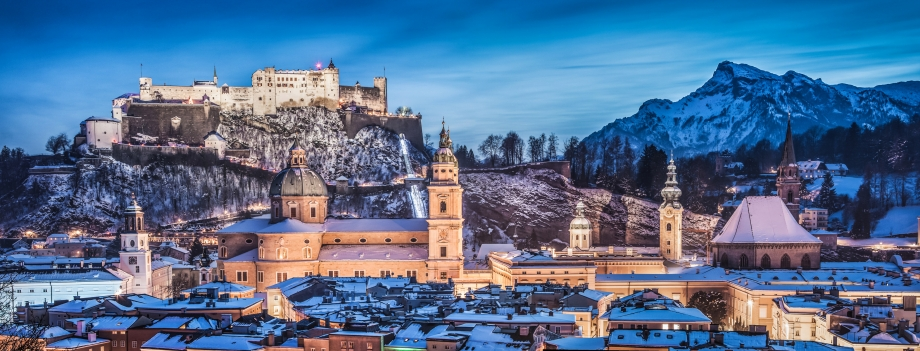 Panoramic view of the historic city of Salzburg with Hohensalzburg Fortress in winter at blue hour, Salzburger Land, Austria - AspirantSG