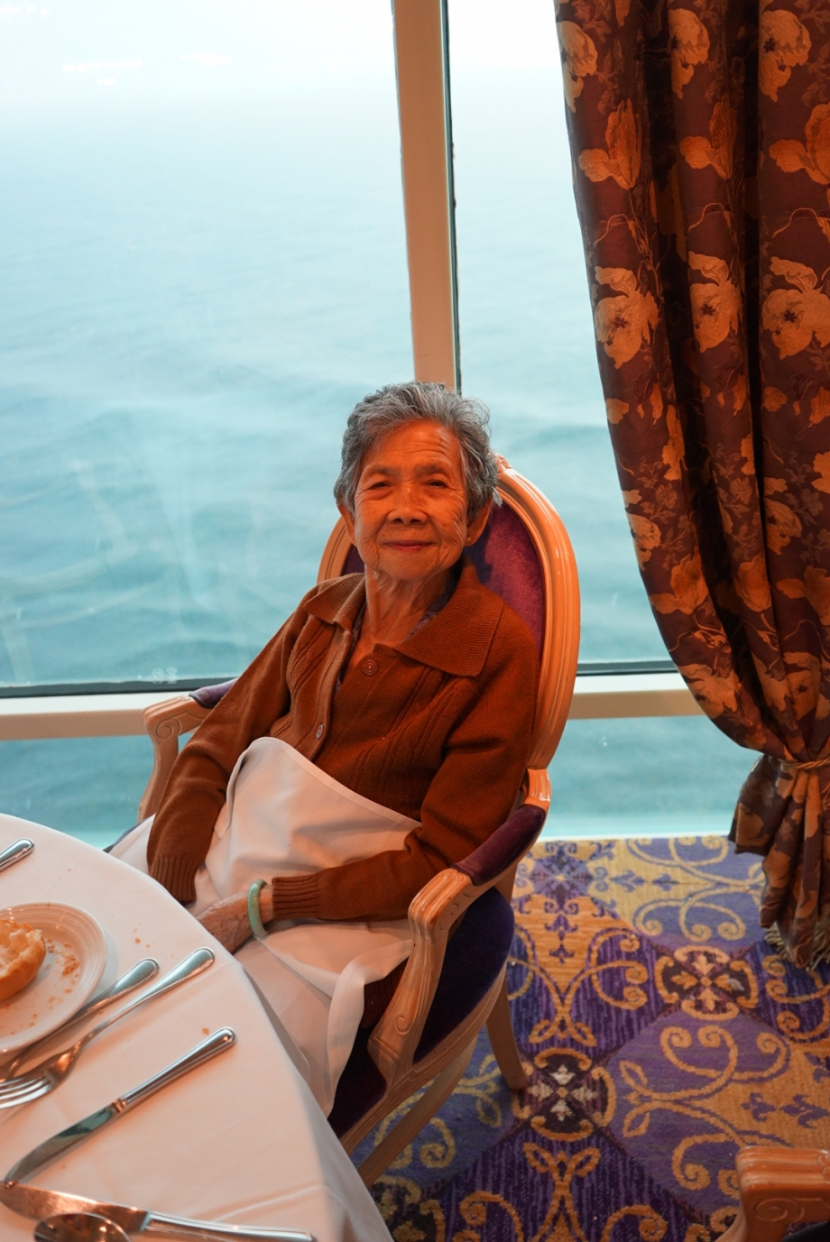Grandmother looking please with meals on Royal Caribbean - AspirantSG