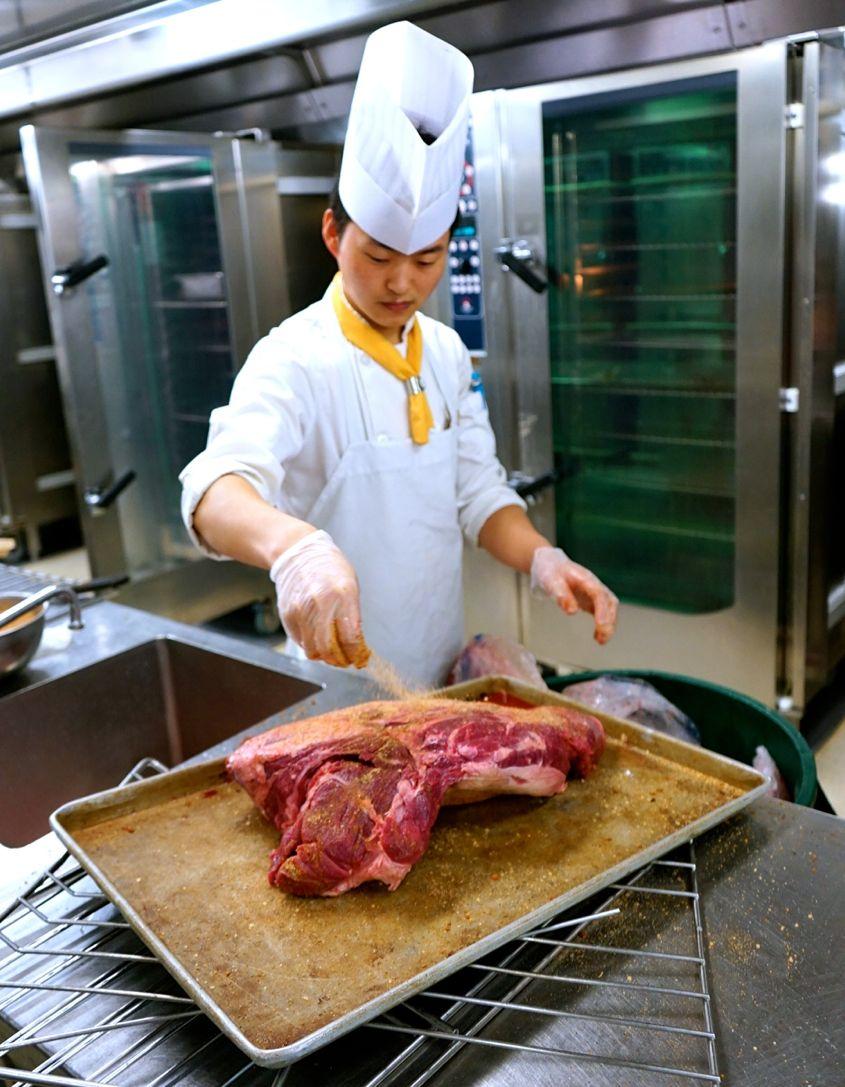 Cook seasoning beef on Mariner Of The Seas Royal Caribbean - AspirantSG