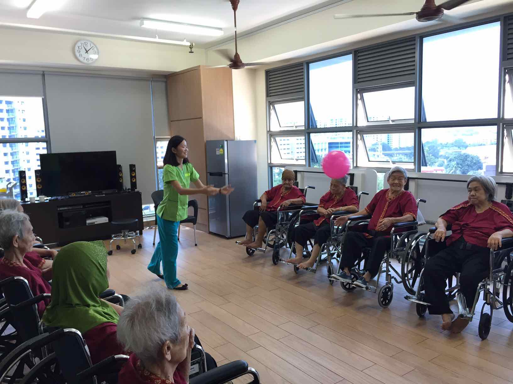 ball-playing-with-residents-at-ntuc-health-nursing-home-aspirantsg