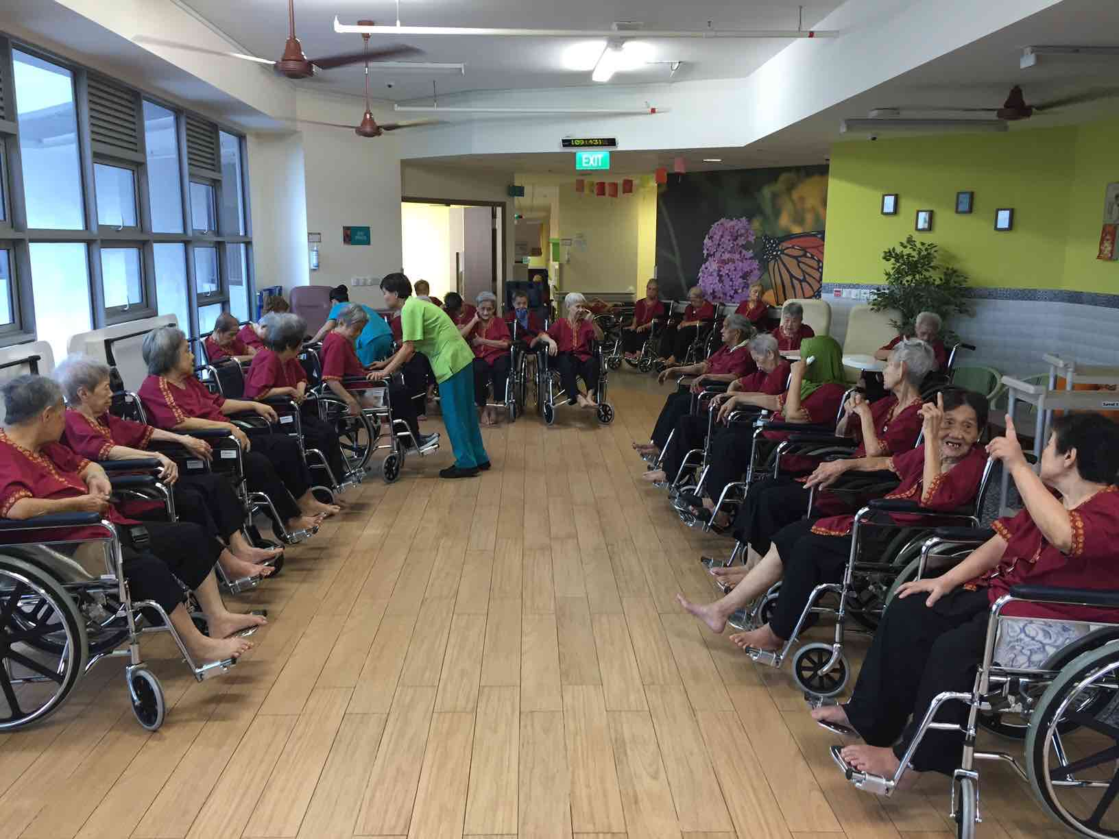 sandy-with-female-residents-on-level-6-of-ntuc-health-nursing-home-aspirantsg
